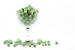 Frozen peas. In small glass Royalty Free Stock Images