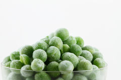 Frozen peas. In small glass Royalty Free Stock Photo