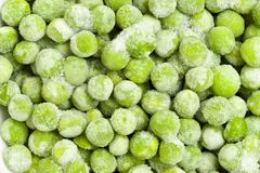 Frozen peas. Closeup of green frozen peas, a healthy snack for babies Royalty Free Stock Photos