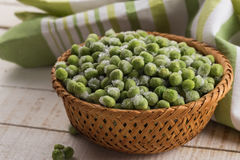 Frozen peas in bowl Royalty Free Stock Photo