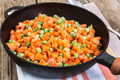 Frozen peas and carrots for cooking on a pan Stock Images