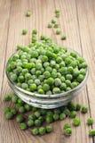 Frozen peas in a glass bowl Stock Photos