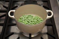 Frozen peas in pot Stock Image