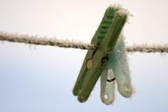 Frozen pegs Stock Image