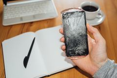 Frozen phone in man hand. Cold call concept royalty free stock photos