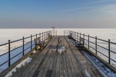 Frozen pier Stock Image