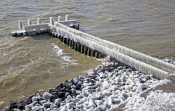 Frozen pier in Afsluitdijk Royalty Free Stock Photos