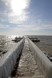 Frozen pier in Afsluitdijk Royalty Free Stock Photo