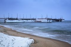 Frozen pier at Baltic Sea in Gdansk. Snowy winter at Baltic Sea in Gdansk, Poland Royalty Free Stock Image