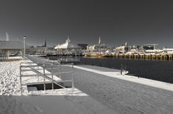 Snowy Pier and Bandstand at Dawn, Dublin Ireland. Old Victorian Bandstand in winter with the Earl of Pembrook tall ship docked in background in Dun Laoghaire stock photography