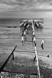 Frozen pier Stock Images