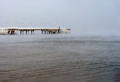 Frozen pier, lonely man Royalty Free Stock Photography