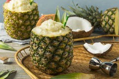 Frozen Pina Colada Cocktail in a Pineapple. With a Garnish Stock Image