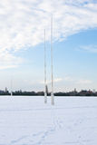 Frozen Pitch. Snow-covered rugby pitch and posts Stock Images