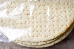 Frozen pizza dough. Frozen ready-made pizza dough in plastic packaging Royalty Free Stock Photography