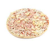 Frozen pizza isolated. Frozen pizza with the cheese, ham and pineapples isolated over the white background Royalty Free Stock Image