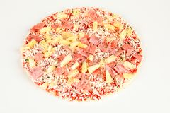 Frozen pizza with pinapple and ham. A frozen pizza with pinapple and ham Royalty Free Stock Photo