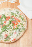 Frozen pizza in a plastic wrap royalty free stock images