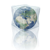 Frozen planet earth. Europe, Africa and Asia. Planet earth inside 3D ice cube. Elements of this image furnished by NASA Royalty Free Stock Images