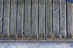 Frozen planks of old pier at winter morning Stock Photos