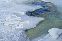Frozen Platte River. Winter landscape of the frozen Platte River as it empties into Lake Michigan at Sleeping Bear Dunes National Lakeshore, Michigan, USA stock images