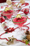 Frozen Pomegranate Margaritas. Two frozen pomegranate margaritas cocktails on Christmas decorated holiday table with Christmas ornaments. Holiday cocktails Stock Images