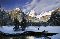 Frozen pond in front of mountain top Stock Photos