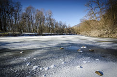 Frozen pond Stock Photography