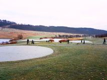 Frozen pond in golf court. Nice and beautiful scenary of golf court Stock Photo