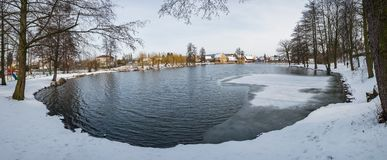 Frozen pond lake in countryside village of Ustek. Czech republic stock images