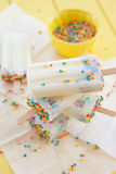 Frozen popsicles with sprinkles Stock Images