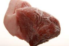 Frozen pork. A piece of pork isolated on white background Stock Photos