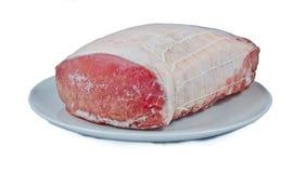 Frozen pork. Meat on white dish stock image