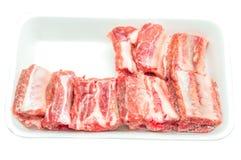 Frozen pork rib. In the foam tray royalty free stock photos