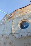 Frozen porthole on the old ship Stock Image