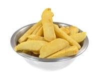 Frozen potato steak fries in bowl Stock Images