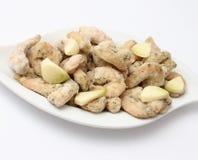 Frozen prawns with garlic. Some frozen prawns with fresh garlic Stock Images