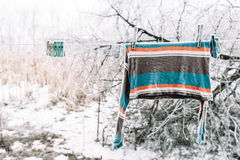 Frozen pullover on clothesline outside. Strong russian winter. Cold, early frosts, hoar concept Stock Photography
