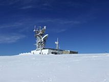 Frozen radio-locator. Frozen radio location set against blue sky Royalty Free Stock Photography