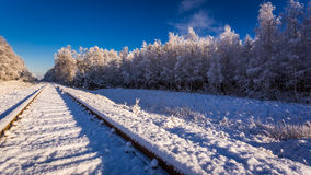 Frozen railway line in winter at sunrise Royalty Free Stock Images