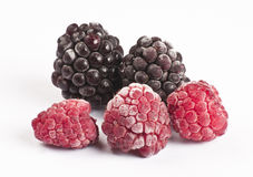 Frozen raspberries and blackberries Stock Images