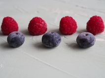 Frozen raspberries and blueberries royalty free stock image