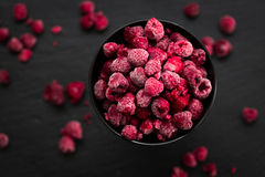 Frozen Raspberries in Bowl, Covered with Ice on Dark Background, Top View Royalty Free Stock Images