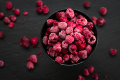 Frozen Raspberries in Bowl, Covered with Ice on Dark Background, Top View Royalty Free Stock Image