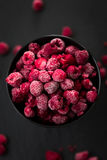 Frozen Raspberries in Bowl, Covered with Ice on Dark Background, Top View. Frozen Raspberries in Bowl, Covered with Ice on Dark Background Stock Photography