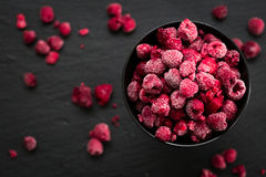 Frozen Raspberries in Bowl, Covered with Ice on Dark Background, Top View Stock Photos