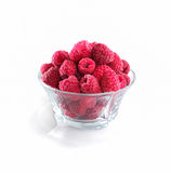 Frozen raspberries in a glass bowl isolated on white background.  Stock Photo