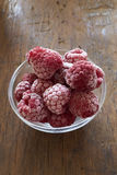 Frozen Raspberries in a glass bowl Stock Photos