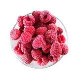 Frozen raspberries in a glass bowl - top view - isolated on white Stock Photo