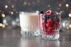 Frozen raspberries in glass and yogurt stock photo